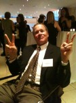 Geoffrey at the Team Fox Reception giving his Parker's Climb Victory Sign